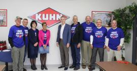 Congressman Anthony Brindisi stands with employees of Kuhn North America's Vernon, New York, Regional Distribution Center.