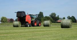 A view of a VB 3160 ejecting a bale from behind the machine