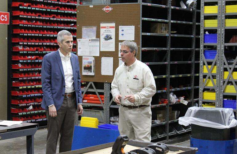 Representative Brindisi walks the warehouse with Jerry Smith.