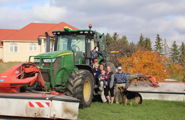 Family members of Divorne Farms pictured with their KUHN FC Triple Mower Conditioner.
