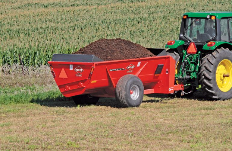 SL 110 fully loaded with manure in a field.