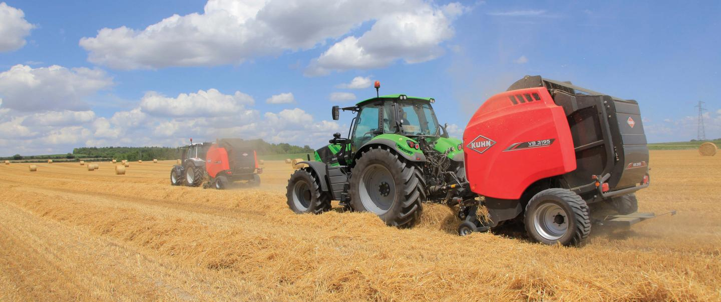 Two VB 3195 balers baling straw in the field.